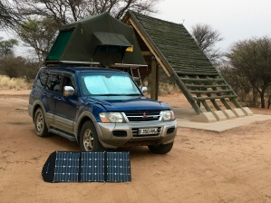 Our campsite setup the first night. Look at our new solar panel and roof-top tent!
