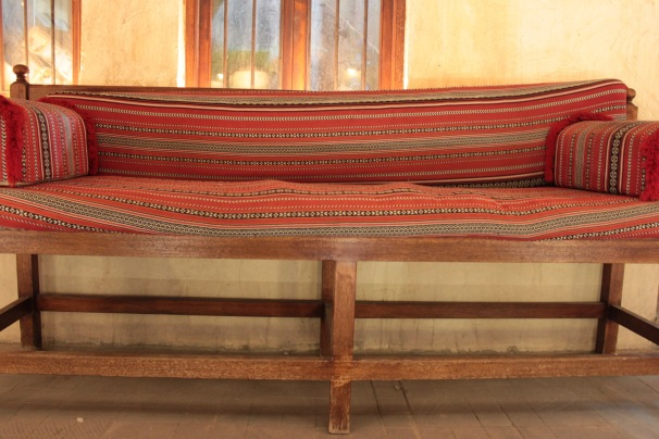 fabric covered wooden bench